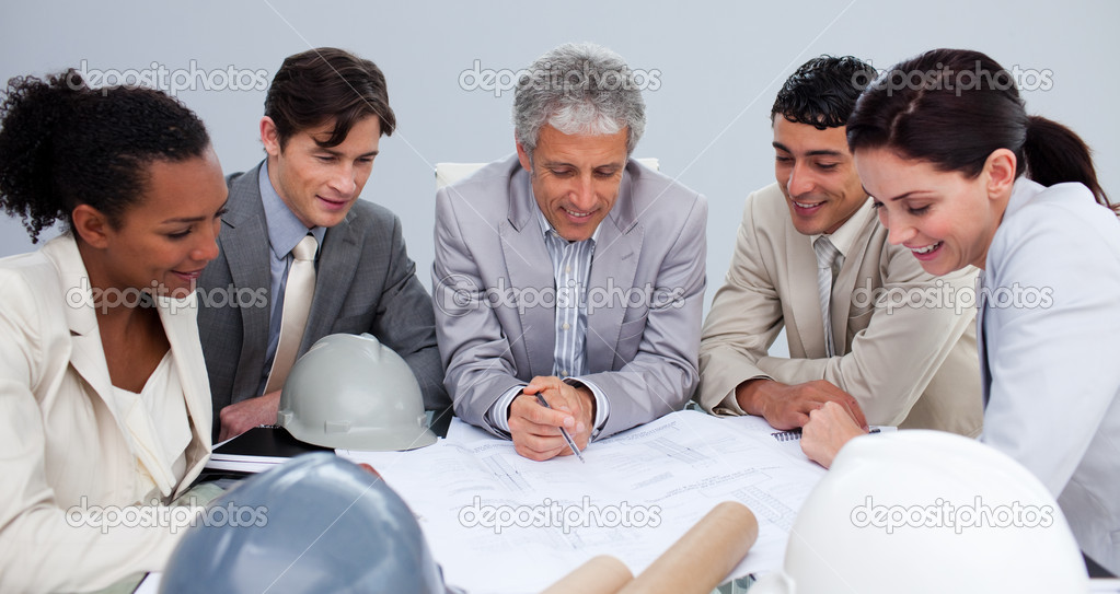 Group of engineers studying plans in a meeting — Stock Photo #10286554