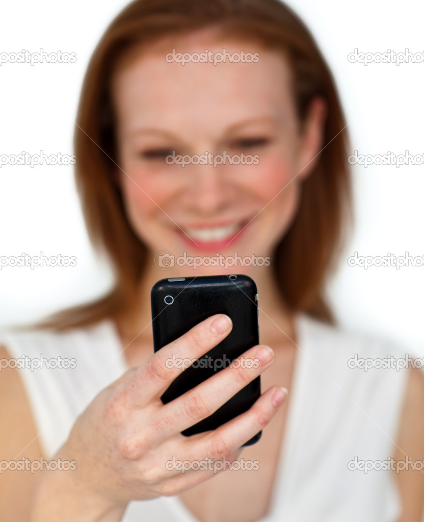 Focus on a black mobile phone against a white bakground — Stock Photo #10287557