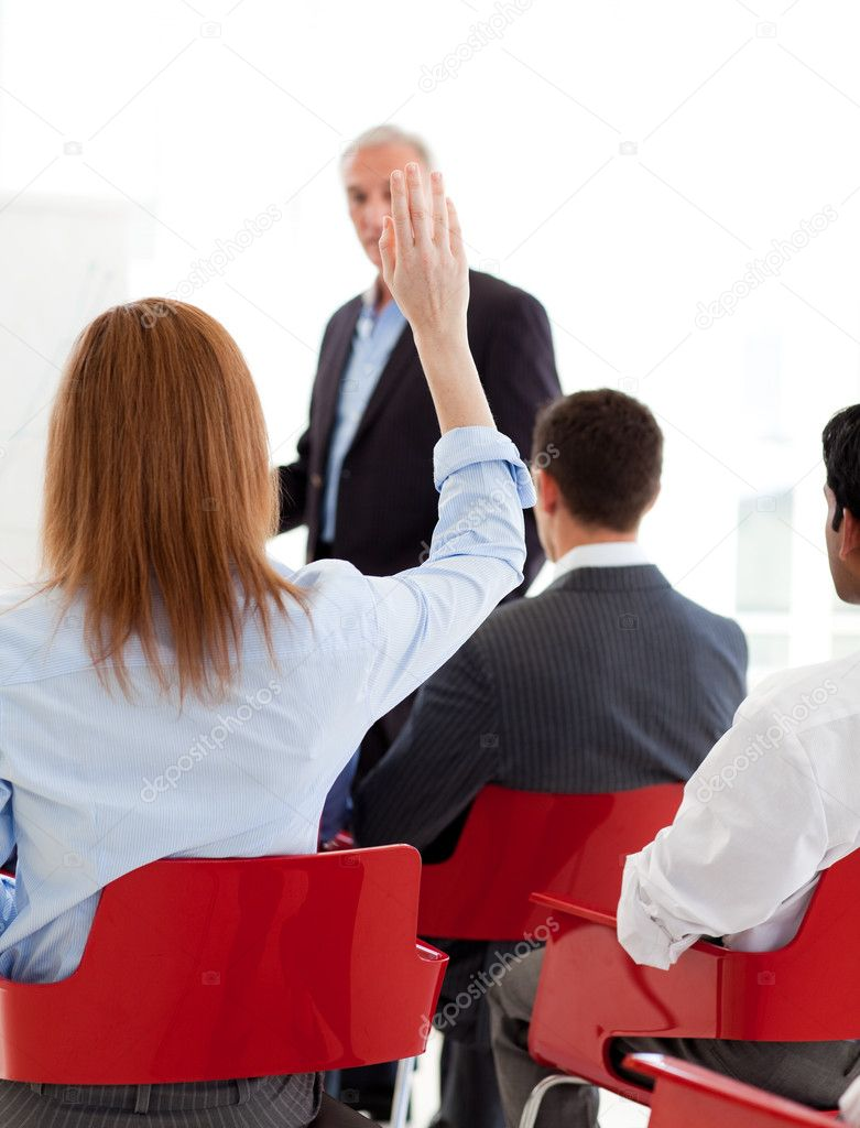 Businesswoman raising her hand up at a conference. Business concept. — Stock Photo #10287696