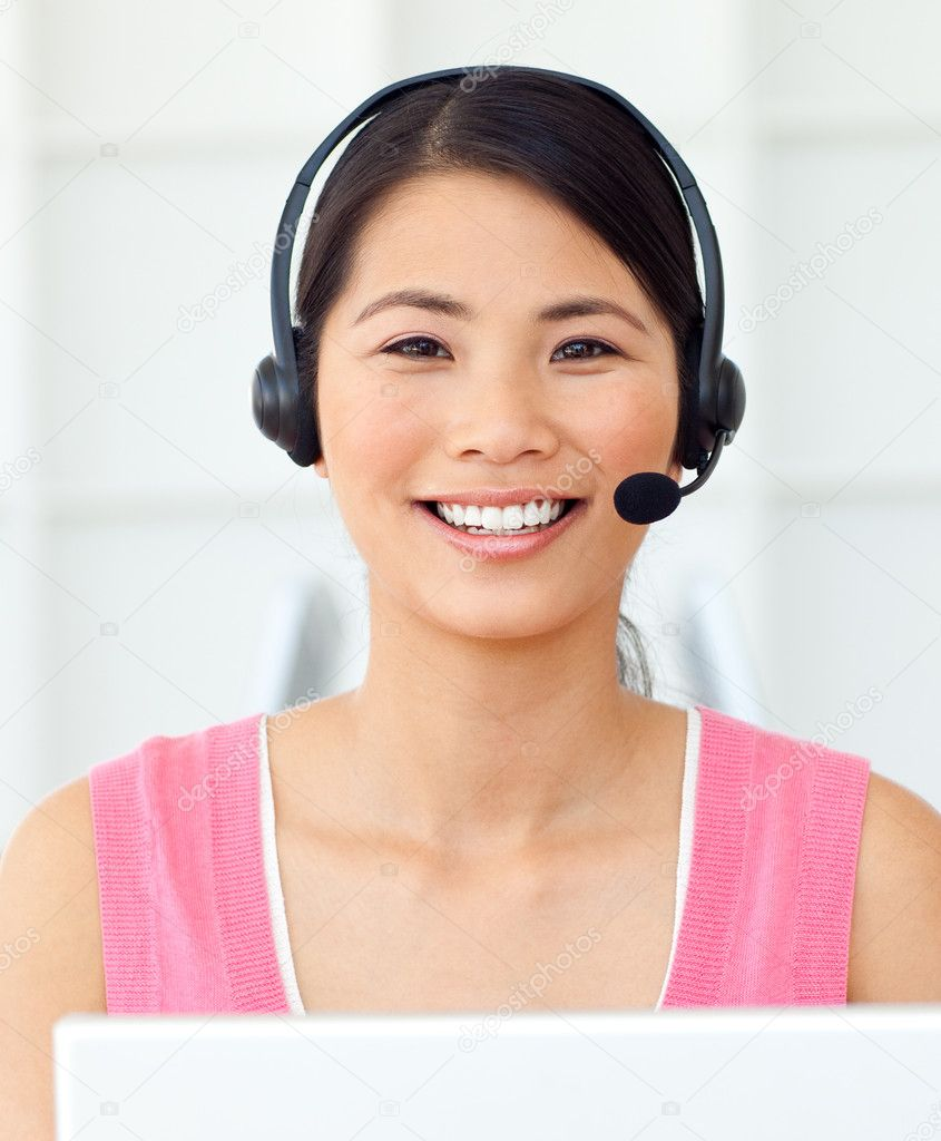 Attractive Businesswoman with headset on at work — Stock Photo #10288441