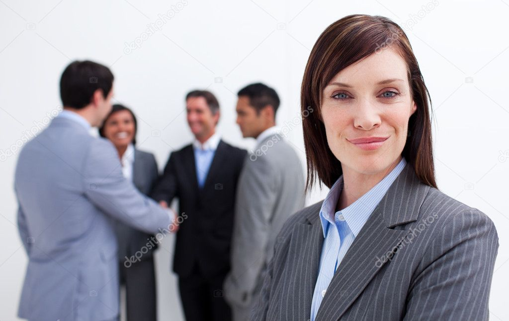 Confident manager with her team in the background. Business concept.  Stock Photo #10288877