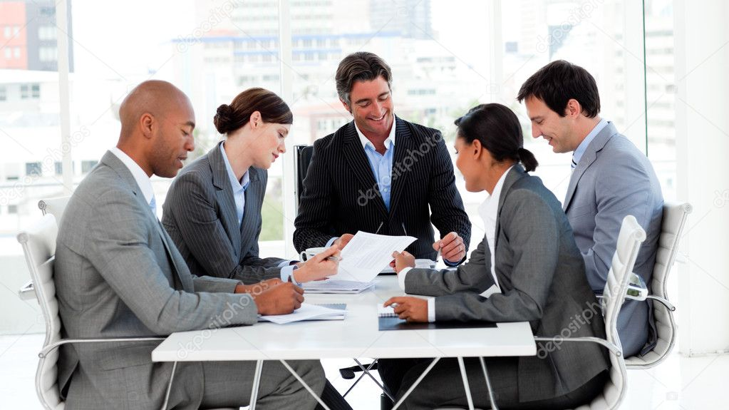 Multi-thnic business team discussing a new strategy in a meeting — Stock Photo #10288966