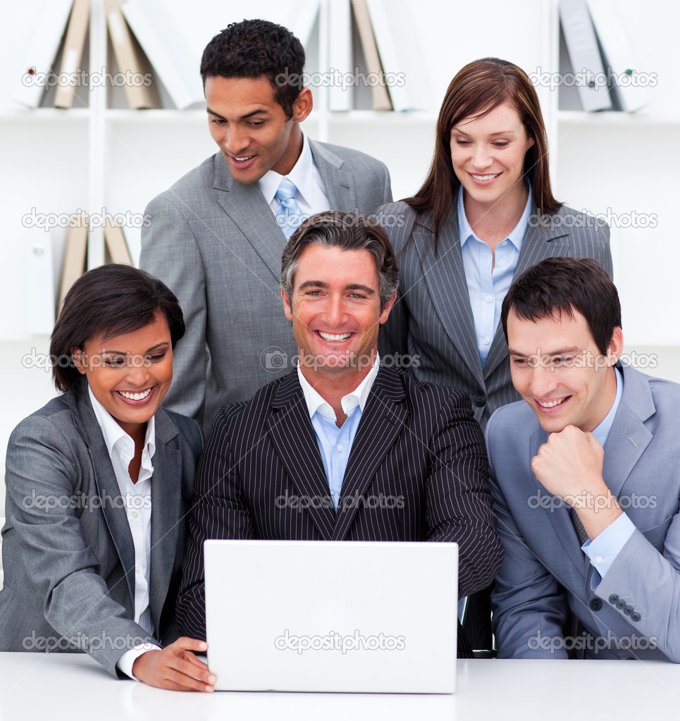Cheerful business team looking at a laptop in the office — Stock Photo #10289196