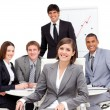Charming businesswoman sitting in front of her team — Stock Photo