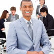 Afro-american businessman sitting in front of his colleagues — Stock Photo