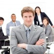 Charming manager with folded arms in front on his team — Stock Photo
