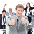 Happy manager with thumbs up in front of his team — Stock Photo