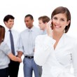 Attractive businesswoman on phone in front of her team — Stock Photo #10290073