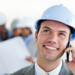 Focus on a male arhitect with a hardhat on phone — Stock Photo