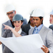 A diverse group of architects studying a plan — Stock Photo