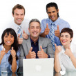Stock Photo: Smiling business group with thumbs up