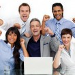 Fortunate business team punching the air in celebration - Stock Photo