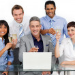 Lucky business team toasting with Champagne — Stock Photo #10290123