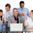Cheerful business team toasting with Champagne — Stock Photo