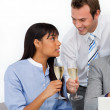Two cheerful colleagues toasting with Champagne — Stock Photo