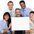 Royalty-Free Stock Photo: A business group showing diversity holding a white card
