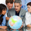 International business looking at a terrestrial globe — Stock Photo #10290132