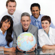 Confident business partners holding a globe - Stock Photo