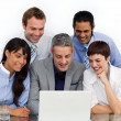 A business group showing diversity using a laptop — Stock Photo #10290138