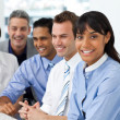 A diverse business group sitting in a line — Stock Photo #10290147