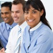 Stock Photo: Multi-ethnic young business team sitting in a row