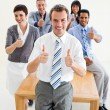 Fortunate international business team with thumbs up — Stock Photo