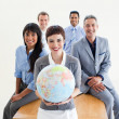 Foto Stock: Multi-ethnic business holding terrestrial globe