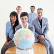Confident business holding terrestrial globe — Stock Photo #10290196