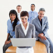 Stock Photo: Multi-ethnic business team using a laptop