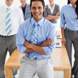 Royalty-Free Stock Photo: Smiling multi-ethnic Business partners standing around a table