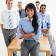 Royalty-Free Stock Photo: Assertive manager with folded arms in front of her team