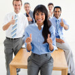 Succesfull co-workers with thumbs up — Stock Photo