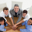 Stock Photo: International business team with hands together