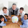 Smiling business holding a globe - Foto de Stock