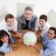Stock Photo: Smiling business holding a globe