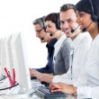 Confident customer service representatives with headset on — Stock Photo #10290243