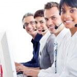 Multi-ethnic customer service representatives with headset on — Stock Photo