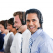 Enthusiastic business working in a call center — Stock Photo
