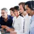 Cheerful business working in a call center — Stock Photo #10290270