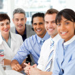 Portrait of multi-ethnic business team at work - Stock Photo