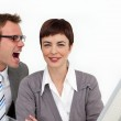 Young businessman shouting into his colleague's ear — Stock Photo
