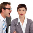 Stock Photo: Angry businessman shouting into his colleague's ear
