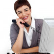 Joyful Businesswoman holding a telephone at her desk — Stock Photo #10290362