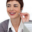 Self-assured businesswoman with headset on — Stock Photo #10290368
