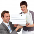 Smiling Businesswoman bringing a stack of folders to her manager — Stock Photo