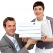 Young Businesswoman bringing a pile of folders to her manager — Stock Photo