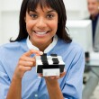 Self-assured businesswoman holding a business card holder — Stock Photo