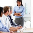 Self-assured businesswoman presenting to her team — Stock Photo #10290506
