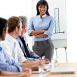 Assertive ethnic businesswoman doing a presentation to her team — Stock Photo