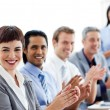 Multi-ethnic business clapping a good presentation — Stock Photo #10290517